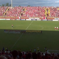 Photo taken at Estádio Arena Joinville by Andrei A. on 4/15/2012