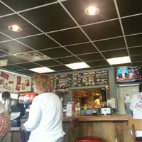 Photo taken at Village Burger by Travis M. on 7/27/2012