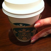 Photo taken at Starbucks by ゆたぽん on 4/7/2012