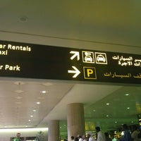 Photo taken at International Arrivals at KFIA by Michael P. on 7/10/2012