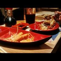 Photo taken at SushiLoko by Cyntia C. on 3/18/2012