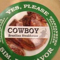 Photo taken at Cowboy Brazilian Steakhouse by Melissa T. on 6/17/2012