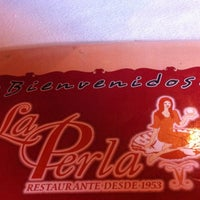 Photo taken at La Perla by Glenda M. on 3/16/2012