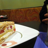 Photo taken at Paris Cafe by Alanna H. on 2/15/2012