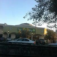 Photo taken at Fresh & Easy Neighborhood Market by Steve P. on 2/15/2012