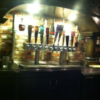 Photo taken at BJ's Restaurant and Brewhouse by Shaun E. on 4/15/2012