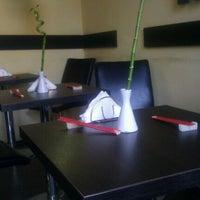 Photo taken at Sushi Garden by Madalina R. on 5/13/2012