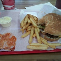 Photo taken at Apollo Burgers by Bee M. on 5/15/2012