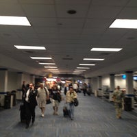 Photo taken at Concourse C by Tim J. on 4/5/2012