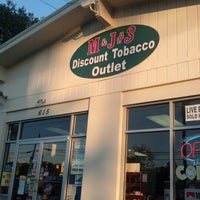 Photo taken at M & J #3 Discount Tobacco Outlet by Zacchaeus N. on 9/10/2012