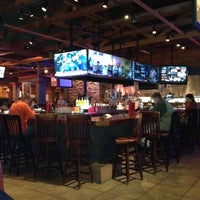 Photo taken at Smokey Bones Bar & Fire Grill by Lisa A. on 6/20/2012