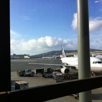 Photo taken at Gate 75 by Laetitia M. on 3/19/2012