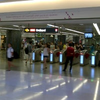 Photo taken at Orchard MRT Station (NS22) by Sandy L. on 8/21/2012