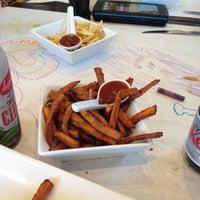 Photo taken at Umami Burger by Muneer A. on 7/8/2012