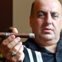 Photo taken at Bolivar Cigar Club by Thrillist on 9/11/2012