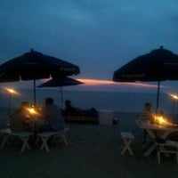 Photo taken at Navy Beach Restaurant by Cecily S. on 7/4/2012