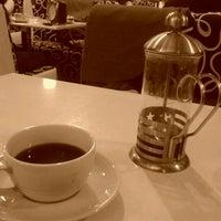 Photo taken at Cafe Dejavu XL by mustafa d. on 2/7/2012