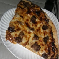 Photo taken at Big Tomato Pizza Co. by Romelle S. on 4/15/2012