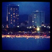 Photo taken at Memorial Day Lantern Floating Ceremony @ Ala Moana Beach Park by Carol N. on 5/29/2012