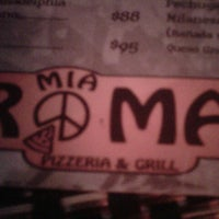 Photo taken at Roma Parrilla Pizza Bar by Adrián A. on 8/26/2012