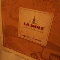 Photo taken at La Mole by Giselle B. on 3/4/2012