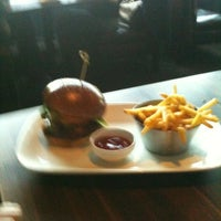 Photo taken at Earls Kitchen & Bar by Kim S. on 4/11/2012