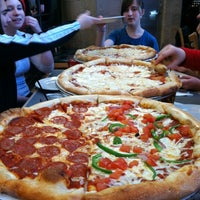 Photo taken at Dewey's Pizza by Joe on 3/23/2012