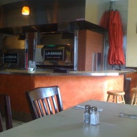 Photo taken at La Brasa Latin Cuisine by Juan M. on 7/20/2012