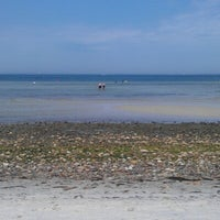 Photo taken at Little Island Beach by Tom R. on 7/1/2012