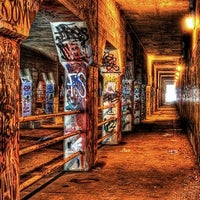 Photo taken at Krog Street Tunnel by Emmett D. on 8/12/2012