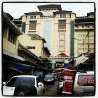 Photo taken at Pasar Baru Trade Center by Masamu K. on 7/20/2012