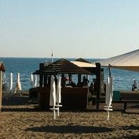 Photo taken at Corallo beach by Pietro V. on 6/18/2012