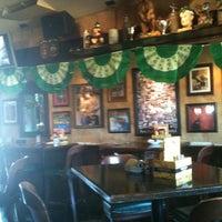 Photo taken at Finn McCool's Irish Sports Pub by Kelly S. on 3/18/2012