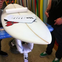Photo taken at Jack's Surfboards by Kym C. on 2/18/2012