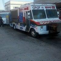 Photo taken at Gigi & Big R Caribbean Soul Food Cart by Jim H. on 3/19/2012