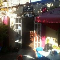 Photo taken at Mango cafe by Tim L. on 3/30/2012