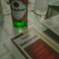 Photo taken at Tauro Restaurant by Jason W. on 6/21/2012