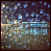 Photo taken at Gate 30 by DJ P. on 6/20/2012
