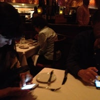 Photo taken at Fleming's Prime Steakhouse & Wine Bar by Eliza Jane C. on 3/18/2012