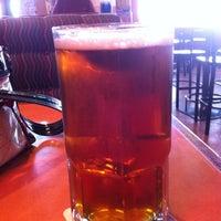 Photo taken at Boston's Restaurant & Sports Bar by Aura C. on 5/25/2012