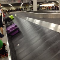 Photo taken at Baggage Belts by Andi M. on 7/7/2012