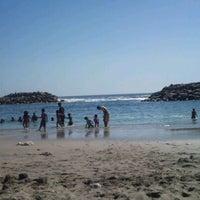 Photo taken at Playa Trocadero by Catalina P. on 2/13/2012