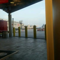 Photo taken at Gate D60 by Shawn M. on 7/4/2012