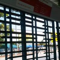 Photo taken at Transmetro Estación Atlántico by Nicolás O. on 8/10/2012