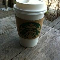 Photo taken at Starbucks by Takako M. on 4/9/2012