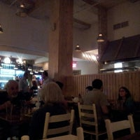 Photo taken at Village Taverna by Alex F. on 9/6/2012