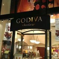 Photo taken at Godiva Chocolatier by Adam D. on 3/21/2012