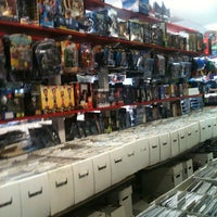Photo taken at Nan's Comics, Games, and Toys by Esther P. on 7/22/2012