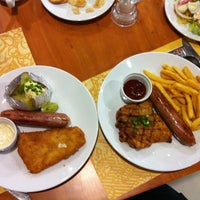 Photo taken at Sizzler by Ooh S. on 3/21/2012