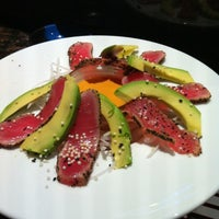 Photo taken at RA Sushi Bar Restaurant by Katie H. on 4/15/2012
